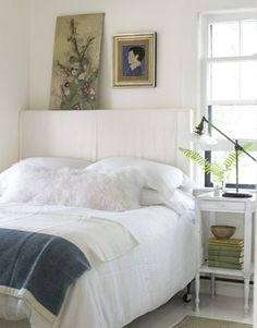 Bright Idea! A linen tablecloth draped over an upholstered headboard adds a subtle sense of depth.
