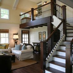 """dark staircase with metal    and the """"yellow"""" paint color is montgomery white by Benjamin Moore"""