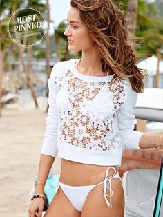 Comfy, cute, kinda flirty…we love this lacy white sweatshirt for the beach—perfect when you want to warm up & still show off your bikini. | Victoria's Secret Lace Pullover