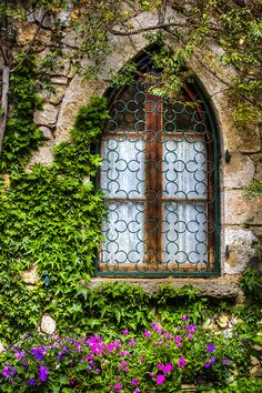 Gothic Style Window with Metal Grille, set in a Stone Wall covered in Ivy ~  in Eze, France ....