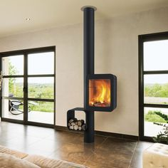 Focus fireplaces : modern fireplaces, stoves and ultra contemporary design BBQ. Custom Fireplace, Modern Fireplace, Fireplace Design, Hanging Fireplace, Stove Fireplace, Foyers, Focus Fireplaces, Contemporary Wood Burning Stoves, Wood Burner