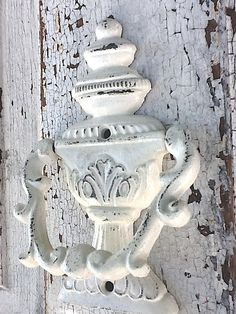 Door Knocker, Old Heirloom Creamy White, Chippy and Distressed. $23.50, via Etsy.