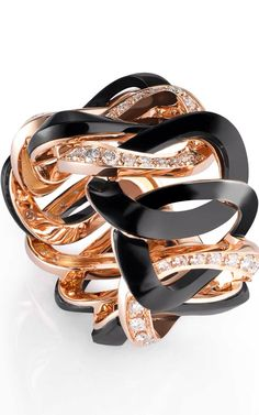 {HAUTE JEWEL DAILY} Ring in pink gold and black natural resin powder set with 54 white diamonds by de Grisogono via: