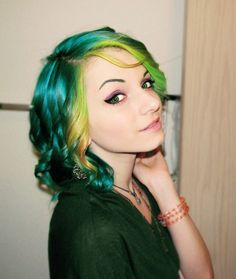 Decided on a color for my hair! Doing face-framing streaks in Enchanted Forest (the blue/green on the back of her hair) .....Manic Panic Enchanted Forest, Green Envy, and Electric Banana.