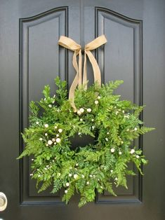 Fern wreath with light touches of babys breath.(use silk fern) could do this in silk ferns or a mix of artifical or real preserved greens and berries. Mistletoe has whitish berries.