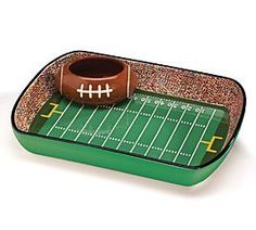 Football Stadium Chip And Dip Sports Serving Set: Handwash only/FDA approved. Football Stadium ceramic chip and dip set. Football shaped dip dish is removable. X 12 X 9 Dip dish: X X 3