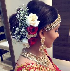 Indian bridal hairstyle inspiration | Fresh flowers hairstyles | Hair bun adorned with with breath flowers, white and red roses | Wedding hairstyles | Wedding updos | Bridal look inspiration | Indian bridal fashion | Credits: Ritika Hairstylist | Every Indian bride's Fav. Wedding E-magazine to read. Here for any marriage advice you need | www.wittyvows.com shares things no one tells brides, covers real weddings, ideas, inspirations, design trends and the right vendors, candid photographers…