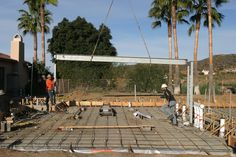 WEEK 7 (01-19-15) STEEL INSTALLATION: The 1st 1,500 pound beam is moved into place.