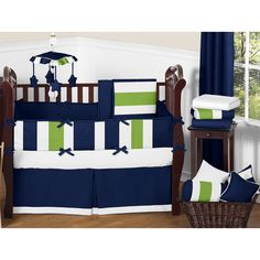 Set up your nursery in high style with this bold designer bedding set. Boasting a large navy, lime green, and white stripe print and solid navy in brushed microfiber, this set adds bold colors to your child's room.