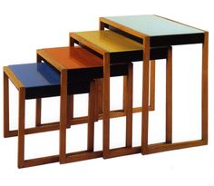 Josef Albers. Set of stacking tables, ca. 1927. Ash veneer, black lacquer, and painted glass. Ranging from 15 5/8 x 16 1/2 x 15 3/4 in. (39.2 x 41.9 x 40 cm) to 24 5/8 x 23 5/8 x 15 7/8 in. (62.6 x 60.1 x 40.3 cm)