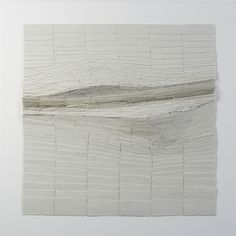 """Thin slates are grouped in rows, ordered from big to small, looking for some movement, ended up with a straight line in the middle to ensure a strong movement."" WIT PORSELEIN / Never Still Always Changing  - Jeanne Opgenhaffen"