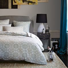 MASTER- Love the wall color, Duvet and Headboard, rug and even the teal of the curtain, also has yellow accents