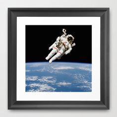 Astronaut Floating Free Framed Art Print by Planet Prints - $31.00