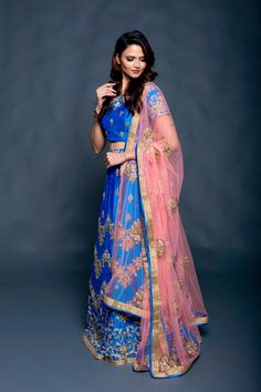 Royal blue bridal lehenga with light coral dupatta heavily embroiled with hand work zardozi
