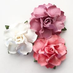 """Our most popular DIY Project supply! These gorgeous handmade flowers measure 1.5"""" across, and are made of premium-quality artisan craft paper. Imagine endless beautiful possibilities for wedding & bri"""