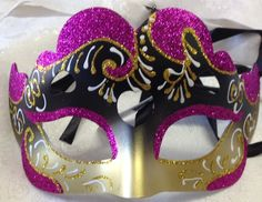 This fancy purple, black and gold design red, orange and green venetian style masquerade mask is new. This mask ribbon tie concept to create a comfortable fit and great to reuse if needed. This mask is 10 inches across and 5.5 inches high Masquerade Masks #reflections_vintage_toronto #masks #masquerade #masqueradeball