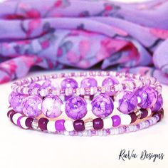 purple and white beads memory wire bracelet stacked pattern ideas layered bead handmade jewelry Memory Wire Bracelets, Handmade Bracelets, Handmade Jewelry, Diy Bracelet Storage, Jewelry Rack, Pattern Ideas, White Beads, Wooden Jewelry, Handmade Wooden