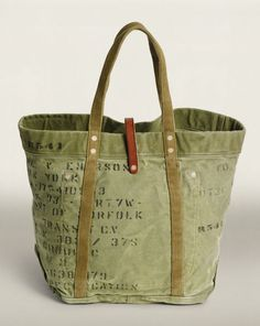 Cotton canvas tote screen-printed with allover distressed military-inspired verbiage. Fastens with a distressed leather strap. Sacs Tote Bags, Tote Purse, Tote Handbags, Canvas Tote Bags, Leather Handbags, Reusable Tote Bags, Camo Purse, Leather Bags Handmade, Handmade Bags
