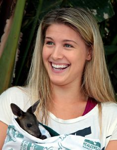 IIn this photo released by Tennis Australia, Eugenie Bouchard of Canada holds a baby wallaby in the players lounge at the Australian Open tennis championship in Melbourne, Australia, Wednesday, Jan. 22, 2014. (AP)