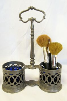 This would be nice in my collection. Vintage Pewter Stand with Cobalt Blue Glass Inserts  by DsTrove, $22.50