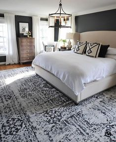 Master Bedroom With Charcoal Walls White Sheer D And Linen Upholstered Wing Platform Bed Ethnic Area Rug