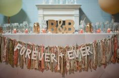 Beautiful vintage wedding decor for the bride and groom reception table.