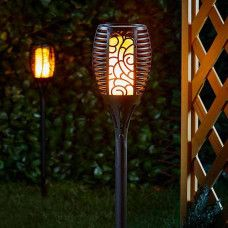 These Gold Armour Solar Lights mimic real flickering flames and add a very nice touch to your outdoor space. The gentle scrollwork allows for the flames to appear realistically. Garden Lanterns, Solar Lanterns, Solar Powered Lights, Solar Lights, Smart Garden, Torch Light, Lighting Solutions, Solar Panels, Outdoor Lighting