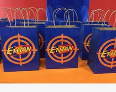 Small label gift bags any theme. Nerf Party Food, Nerf Birthday Party, Happy 6th Birthday, Birthday Gift Bags, Party Gift Bags, Birthday Ideas, Nerf Gun Cake, Paintball Party, Eid Party