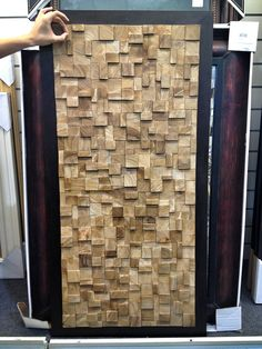 Ben and I saw this at Home Goods today. A cute DIY idea. Stain some plywood and wood-glue on some shim scraps. Handsome wall art.