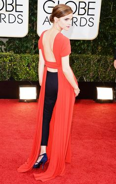 Emma Watson wearing an open back dress with black cropped trousers back in 2012 on the red carpet