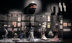 Tim Burton exhibit. Corpse Bride puppets and sand worm from Beetlejuice mounted on the wall.