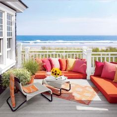 This second-floor teak sundeck is outfitted in Perennials fabrics and a lounge chair by Design Within Reach. | Coastalliving.com