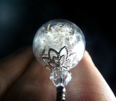 A personal favorite from my Etsy shop https://www.etsy.com/listing/216013129/silver-dandelion-necklace-make-a-wish