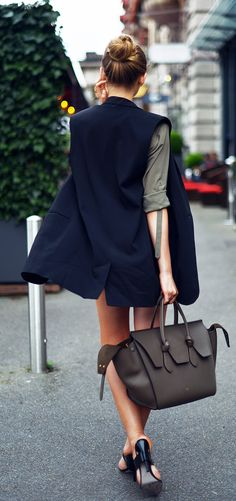 Kristina Bazan is wearing a sleeveless jacket and top from H&M, shoes from Alexander Wang and a bag from Céline