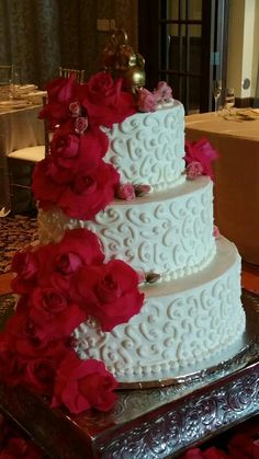 Tiered wedding cake with cascade of fresh roses Specialty Cakes, Creative Cakes, Wisteria, Wedding Cakes, Desserts, Roses, Fresh, Food, Wedding Gown Cakes