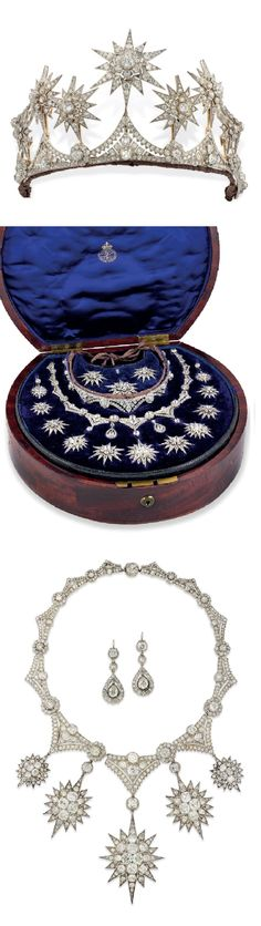 A VICTORIAN DIAMOND STAR PARURE, CIRCA 1870. Comprising a tiara set with diamonds mounted in silver and gold, a necklace of similar design, and a pair of pear shaped diamond ear pendants, in a fitted wooded case, by Collingwood & Son, Conduit Street, with