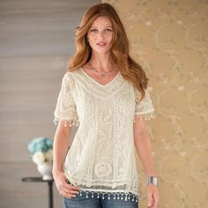 """ANGEL'S WING TOP--Vintage-style details—punched lace ribbon, hand needlework and appliqué, delicate pompom fringe—on a filmy, embroidered mesh top conjure timeless allure to float over jeans, black pants, skirts long or short. Lined. Nylon. Dry clean. Imported. Exclusive. Sizes XS (2), S (4 to 6), M (8 to 10), L (12 to 14), XL (16). Approx. 27-1/2""""L."""