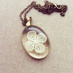 Lace Flower Resin Pendant Resin Jewelry Delicate Pendant. $24.00, via Etsy.