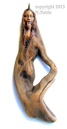 """""""Mermaid Dreams"""" This little fin headed sea nymph measures 12¼ inches tall and 4¼ inches across her widest point. I've added a touch of color to the fin on her head. Eveything else is the natural wood color. Signed and dated: N. Tuttle 10/9/13"""