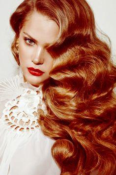Her long glossy, red hair waves, cascade like an ocean!