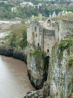 Chepstow Castle (Welsh: Cas-gwent), located in Chepstow, Monmouthshire in Wales, on top of cliffs overlooking the River Wye, is the oldest surviving post-Roman stone fortification in Britain. Its construction was begun under the instruction of the Norman Lord William FitzOsbern, soon made Earl of Hereford, from 1067