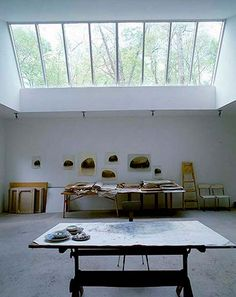 Forest Studio  If you've ever dreamed about quietly working away in the middle of the forest like Snow White, then behold one New York artist's studio surrounded by trees and silence. A transparent roof allows you to daydream while painting, and the interior design is minimal, putting the emphasis on your work.