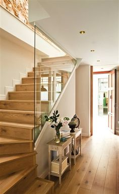beautiful home in Barcelona, natural wood staircase, glass railing