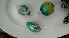 Check out this item in my Etsy shop https://www.etsy.com/listing/258779951/vintage-green-mercury-glass-ornament-set