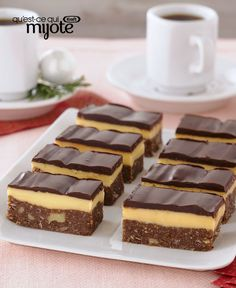 Nanaimo Bars are THE classic Canadian hand-held dessert. Whip up a batch of our homemade Nanaimo bars and celebrate our culinary heritage. Canadian Dishes, Canadian Food, Canadian Recipes, Nanimo Bars, Baking Recipes, Dessert Recipes, Baking Ideas, Dinner Recipes, Yummy Treats