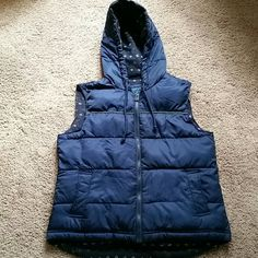 Cozy puffer vest This is a soft and cozy dark blue with green accented puffer vest jacket from Old Navy,  zipper only, no snaps or buttons,  woven body is 100% polyester,  woven lining 100% polyester,  knitted lining acrylic, nylon, lamb's wool, rayon, and angora rabbit hair, filler 100% polyester, third picture shows small white spot located under hood. Old Navy Jackets & Coats Vests