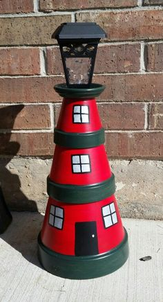 My Christmas lighthouse Flower Pot People, Clay Pot People, Clay Pot Projects, Clay Pot Crafts, Clay Flower Pots, Flower Pot Crafts, Paint Garden Pots, Beach Crafts, Diy Home Crafts