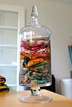 Use an apothecary jar to store scarves                                                                                                                                                     More