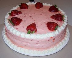 strawberry cake with strawberry filling and strawberry buttercream frosting...all with fresh strawberries   cake
