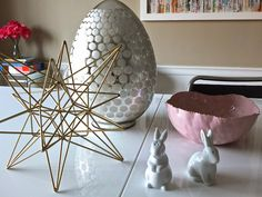 A modern Spring Entertaining table scape: Mix your favorite accessories with a few Easter-specific objects like this beautiful mercury glass egg to give your dining room table a Spring look that can last for months. Sponsored by Happy by Design.